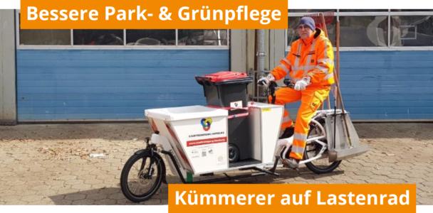 Kümmerer mit E-Lastenrädern für bessere Park- und Grünflächenpflege
